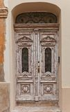Old wooden decorated door in  Zagreb, Croatia Royalty Free Stock Image