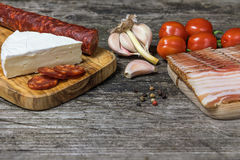 The old wooden desk with hot sausage and cheese Stock Photography