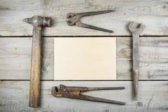 Old wooden desktop. Old rusty carpentry tools. Horizontal mockup Stock Photo