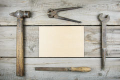 Old wooden desktop. Old rusty carpentry tools. Horizontal mockup Royalty Free Stock Images