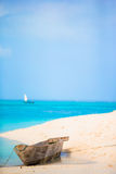 Old wooden dhow on white beach in the Indian Ocean Royalty Free Stock Photos