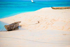 Old wooden dhow on white beach in the Indian Ocean Stock Images