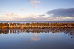 Old wooden dike in Noeth sea Stock Image