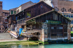 Old wooden dock with boat in Venice, Italy Stock Photo