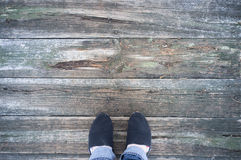 Old wooden dock on the lake. With feet Royalty Free Stock Photos