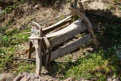 Old wooden donkey saddle. Royalty Free Stock Image