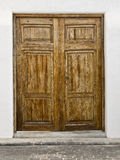 Old Wooden Door. Of a typical Mediterranean white house Royalty Free Stock Image