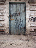 Old wooden door. Old wooden barn door closed padlock Royalty Free Stock Photos