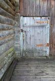 The old wooden door. Old wooden door, the old house Royalty Free Stock Image