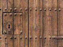 Old wooden door. Ancient and modern lock on old wooden door Stock Image
