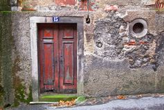 Old wooden door. In a stone wall with a round window. Sintra. Portugal Royalty Free Stock Photos