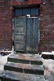 Old wooden door. Shut old wooden door in winter Stock Images