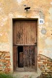 Old wooden door. In brick wall royalty free stock photos