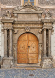 Old wooden door. Historic gate in the town house in Czech Stock Images