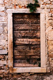 Old wooden door. In Croatian village royalty free stock image