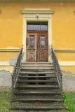 Old wooden door. Stairway leading to an old wooden door Stock Photography