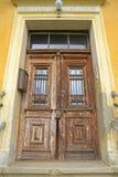 Old wooden door. Frontal view of an old wooden door Stock Photo