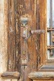 Old wooden door. Frontal view of an old wooden door Stock Photos