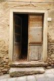 Old Wooden Door Ajar. An old wooden door on a building in Tuscany, Italy, left ajar Stock Photos