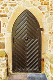 Old wooden door in ancient beautiful building Stock Photography