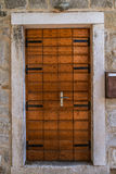 Old wooden door in ancient beautiful building Royalty Free Stock Images