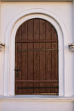 Old wooden door in ancient beautiful building Royalty Free Stock Image