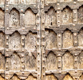 Old wooden door of an ancient church. In Verona, Italy Stock Images