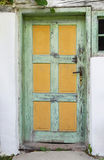 Old wooden door of an ancient farmhouse. Royalty Free Stock Image