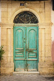 Old wooden door in ancient greek house. Crete Royalty Free Stock Photos