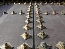 Decorative brass studs stock image