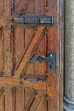 An old wooden door with an antique locks Stock Photography