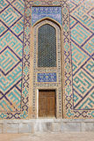 Old wooden door with an arch above it, the Central Asian style Royalty Free Stock Image