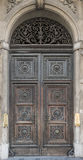 Old wooden door with arch with the bell Royalty Free Stock Image
