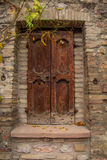 Old wooden door in Assisi Royalty Free Stock Images