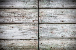 Old wooden door background with cracked paint and rusty nails Royalty Free Stock Image