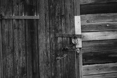 Old wooden door with barn lock stock photo