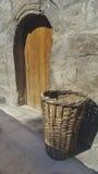 Old wooden door. Basket in front of wooden door Stock Image