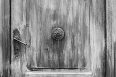 Old wooden door in black and white vintage style Stock Image