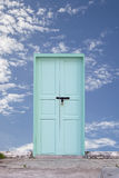 Old wooden door with blue sky background. Stock Photography