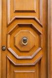 Old wooden door with brass door knocker in Rome Royalty Free Stock Image