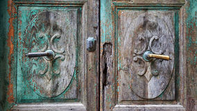 Old wooden door with brass handles.  stock photography