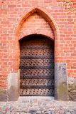Old wooden door. With brick arch facade Royalty Free Stock Image