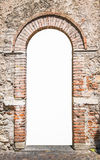 Old wooden door with brick archway. Old wooden door with upper railing and brick archway suitable as a frame Stock Photo