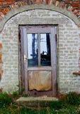 Old wooden door in  brick house Stock Photo