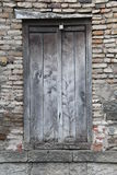 Old wooden door in brick stone wall Royalty Free Stock Photography