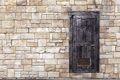 Old Wooden Door on Brick Wall Stock Images