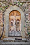 Old wooden door and brick wall Royalty Free Stock Images