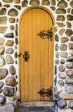 Old wooden door. In a brick wall Stock Image