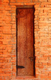 Old wooden door in brick wall Royalty Free Stock Photography