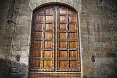 Old wooden door in a brick wall in hdr in Florence Stock Photos